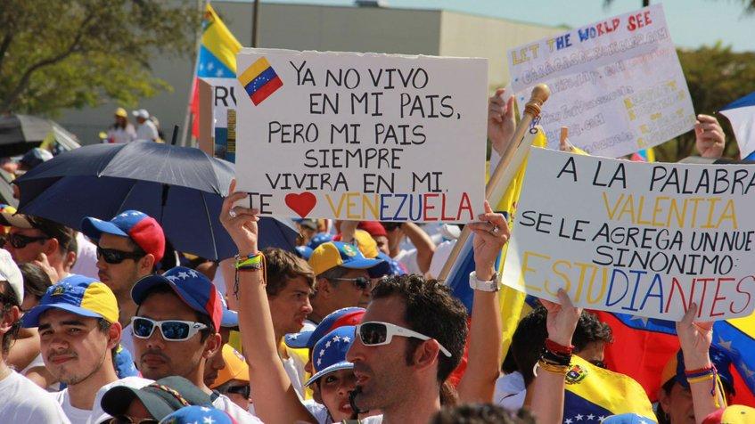 exilio_venezuela_manifestacion_cartel.jpg